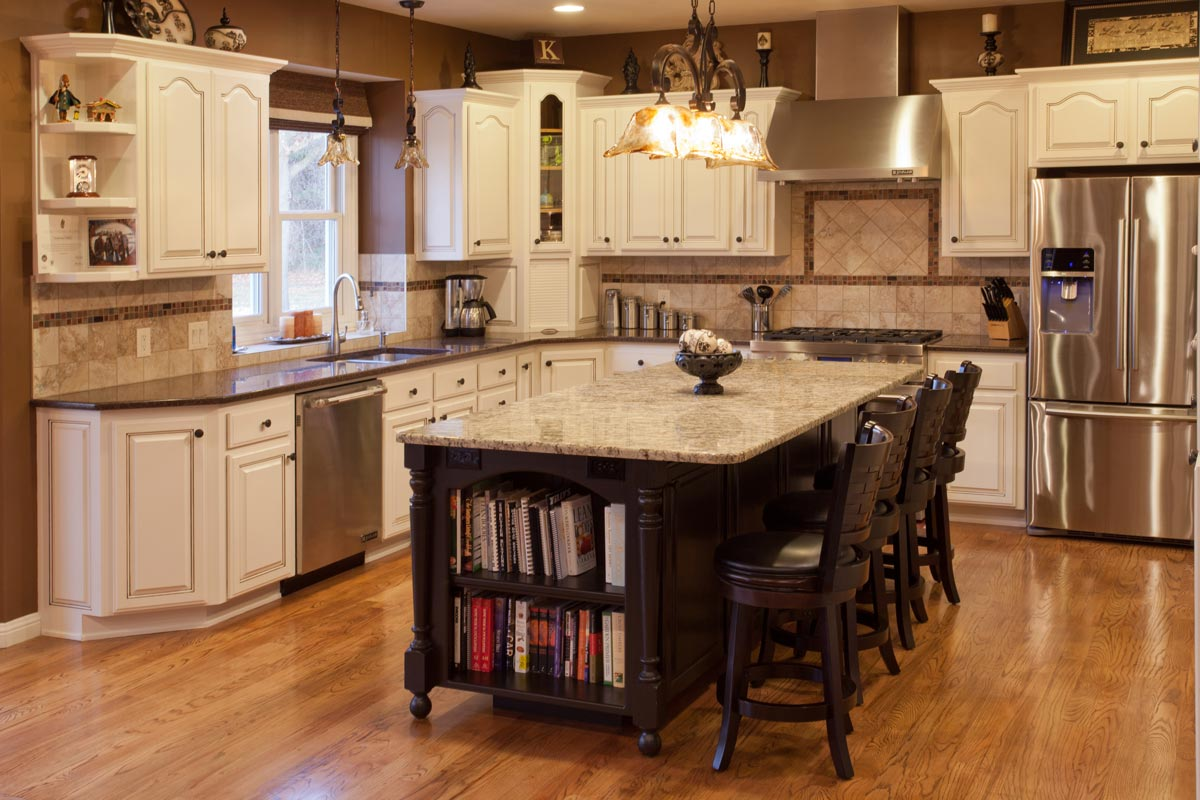 High-end kitchen remodel including a large island with four chairs