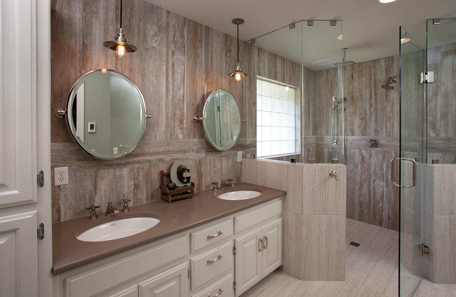 A modern luxury bathroom design with a double sink and shower