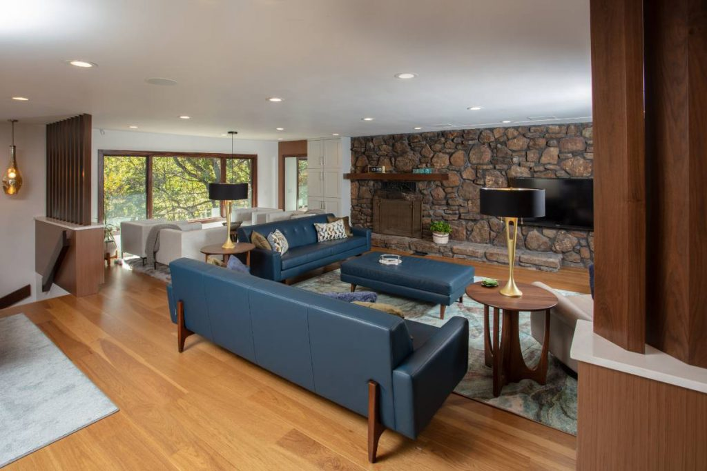 Living room interior design with couches and accessories in a high-end home remodeling project