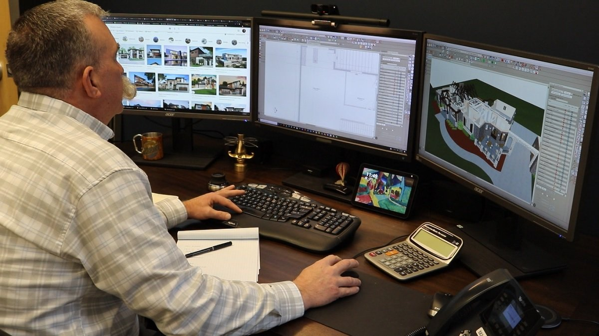 Chad Holgerson working on his drafting computer