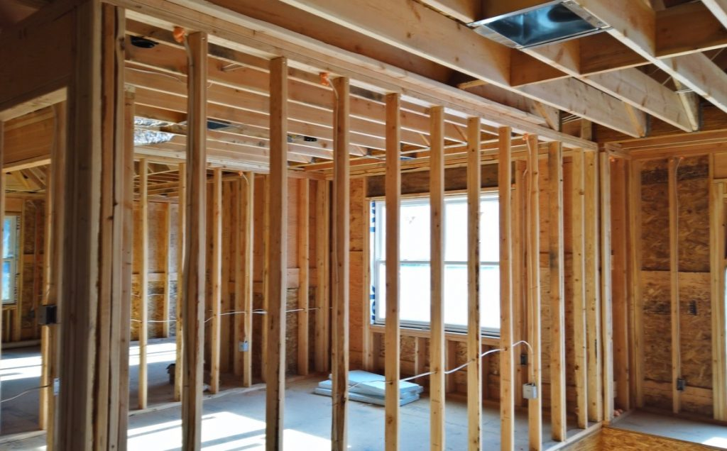 The inside of a new home construction project featuring the wall studs